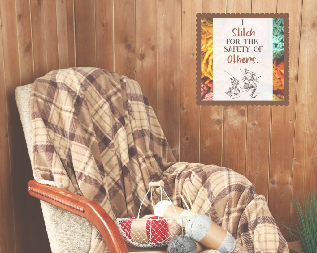 """Chair sitting in a corner with skeins of yarn in the seat. An example of free wall art is on the wall behind the chair, it says """"I stitch for the safety of others."""""""